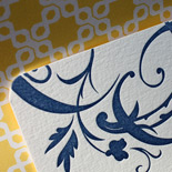 Michelle and Nivritt: one color letterpressed invitation with floral motif and patterned yellow liner