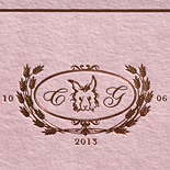 Christin and Giovanni: custom illustration of bride and groom's bunny and wheat, mauve wash with gold foil stamping, custom map liner on bamboo paper