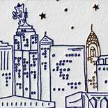 Elizabeth and Shankar: magical Manhattan comes alive in navy letterpress with gold foil stars and Chrysler building. Other highlights include a Ganesh clinging to the Empire State Building, a whimsical drawing of the bride and groom, mad lib reply card, and gold foil food sign.
