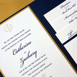 Catherine and Zachary: an elegant wedding invitation with pocket fold, monogram, and gold foil calligraphic flourishes