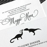Maggie and Andrew - A classic black and white letterpress invitation with patterned envelope and playful dinosaur bride and groom illustration